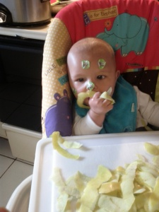"I couldn't resist this cute picture of my little one ""helping"" me peel and core apples. Every recipe I post is done with a very active little one needing to be entertained while I do it. Apple stickers proved to be a great assist."